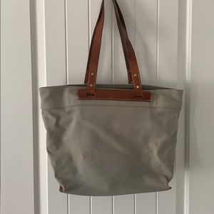 Leather accented tote bag